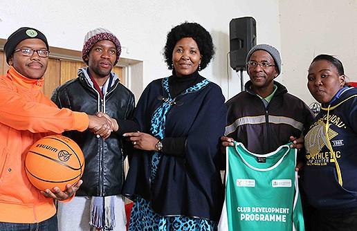 Handover of sport equipment and playing attire